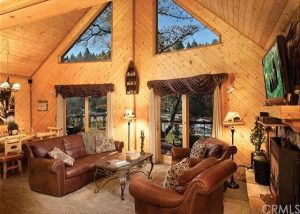 View of timber ranch living room.
