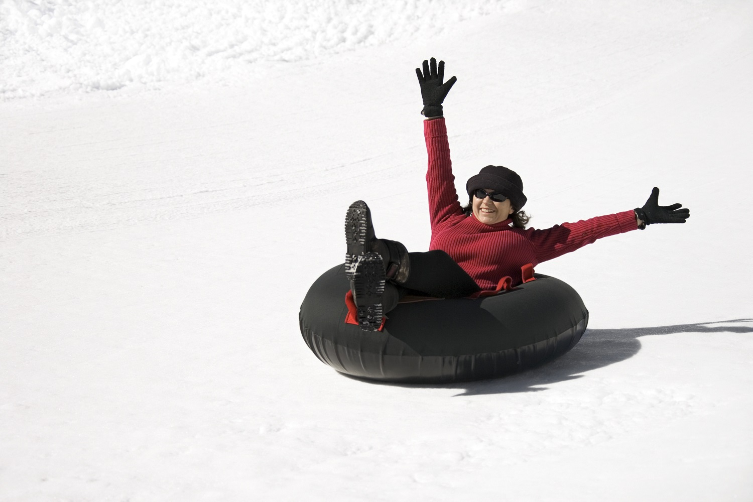 woman tubing in the snow
