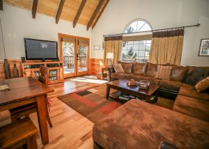 view of the living room of a big bear lakefront cabin
